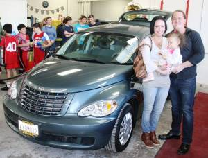 Recipient Ryan Ellis with family & new car